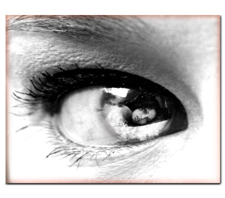 Fine art photography image of an eye with a reflection of a womans portrait in place of the iris.